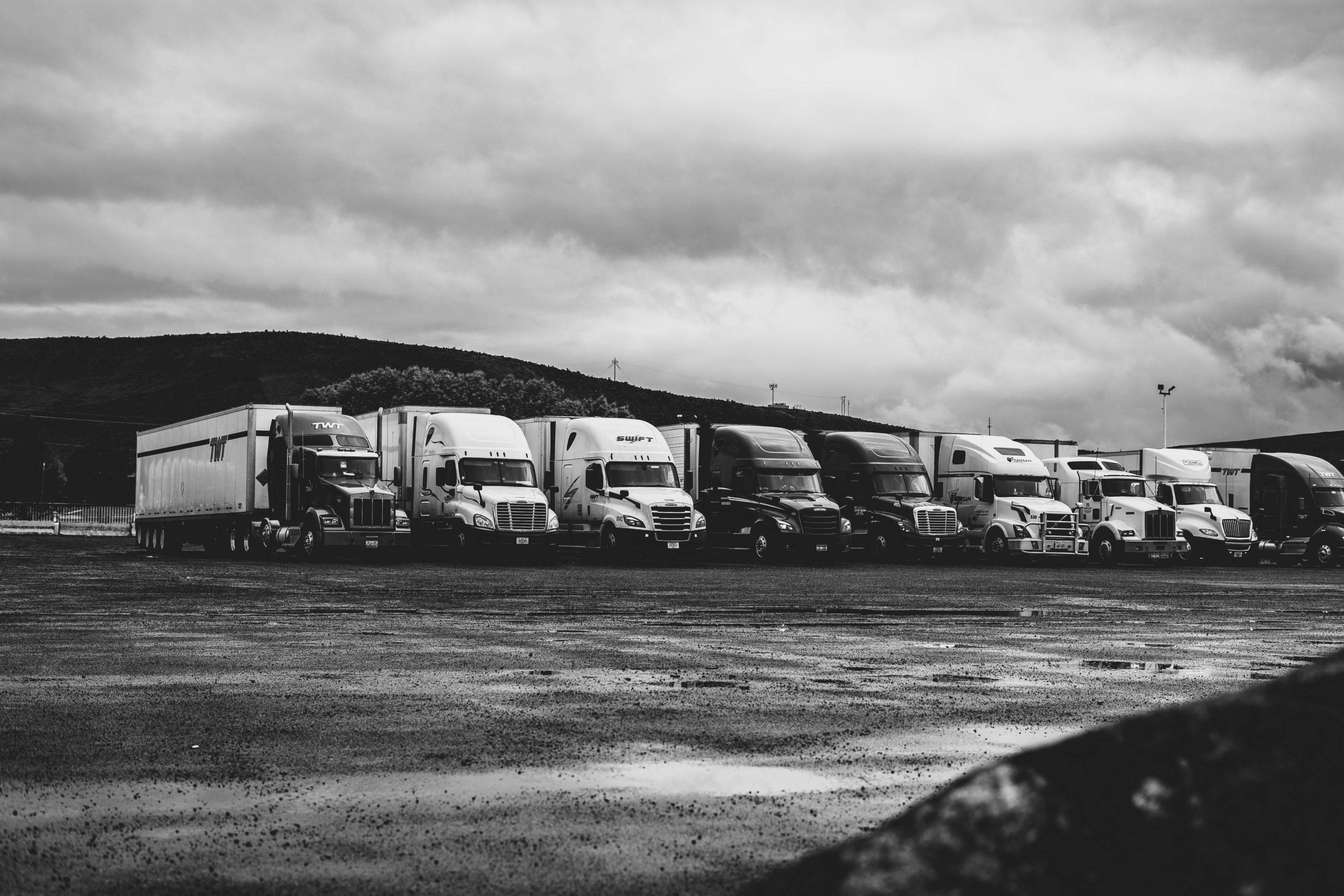 Trucks under clouds